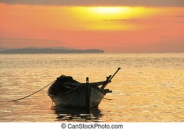 Silhouette of traditional fishing boat at sunrise, Koh Rong island, Cambodia, Southeast Asia