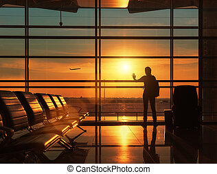 Silhouette of traveling woman