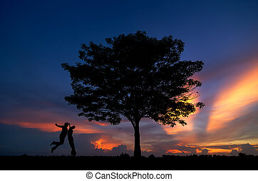 silhouette of trees and men happy