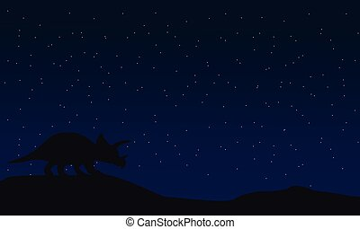 Silhouette of triceratops at night landscape