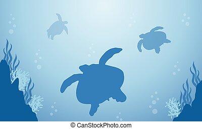 Silhouette of turtle on blue sea landscape
