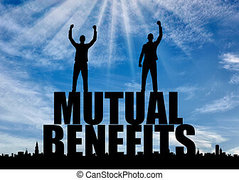 Silhouette of two happy men with raised arms standing on the word mutual benefit