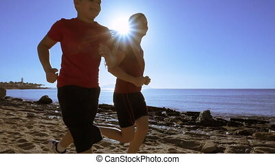 Silhouette of two kids running at morning exersises