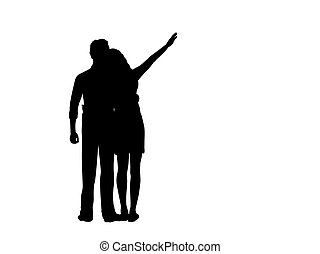 Silhouette of two lovers man and woman look into the distance