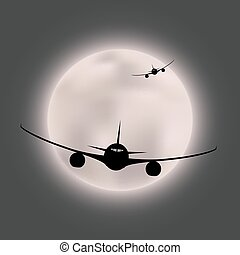 Silhouette of two planes on the background of a bright moon