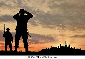 Silhouette of two soldiers with guns
