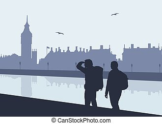 Silhouette of two tourists with backpacks on the Thames...