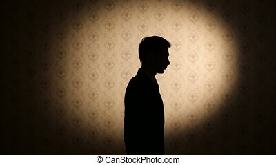 Silhouette of upset man