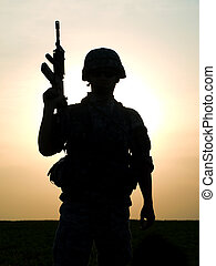 US soldier - Silhouette of US soldier with rifle against a ...