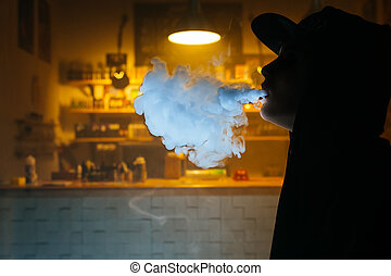 Silhouette of Vaping girl. Young hipster woman vape e-cig at...