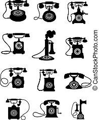 Silhouette of vintage telephones