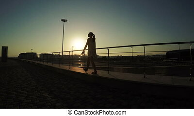 Silhouette of walking girl