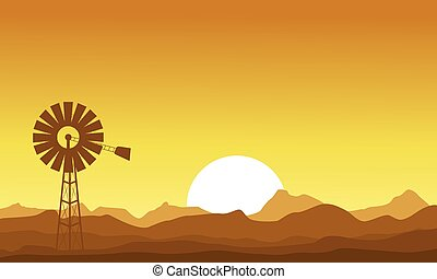 Silhouette of windmill at the sunset