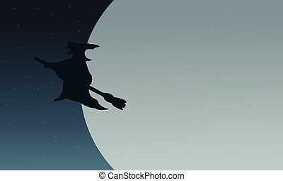 Silhouette of witch flying in moon