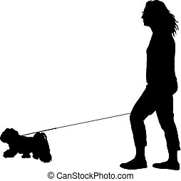 Silhouette of woman and dog on a white background
