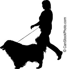 Silhouette of woman and dog on a white