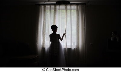 Silhouette of woman at the window
