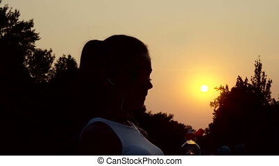silhouette of woman drinking water