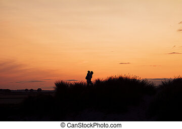 Silhouette of Woman Giving a Piggyback