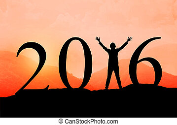 Silhouette of woman jumping over 2016