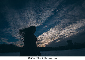 silhouette of woman on a sky background