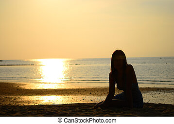 Silhouette of woman on the beach