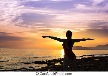 silhouette of woman on the sunset