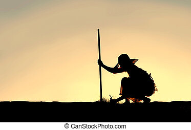 Silhouette of Woman Pulling Weeds from Garden