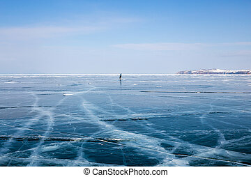Silhouette  of woman skating on the frozen Lake Baikal