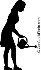 Silhouette of woman watering flowers with can