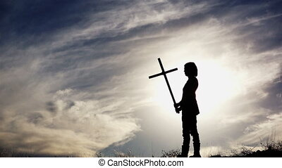 Silhouette of Woman With Cross