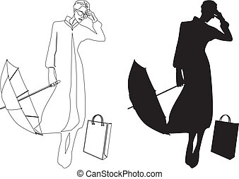 Silhouette of woman with umbrella