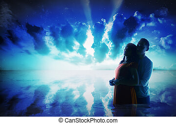 Silhouette of young asian couple on the sea