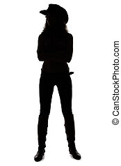 Silhouette of young cowgirl - full length