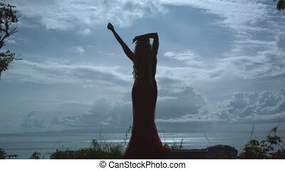 Silhouette of young slim woman
