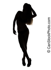 Silhouette ofyoung girl with hands on head