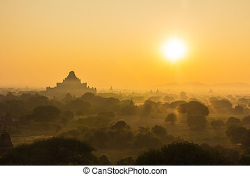 Silhouette pagoda on sunrise time in morning and balloon at Bagan, Myanmar