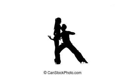 Silhouette pair professional dancers perform samba on white...