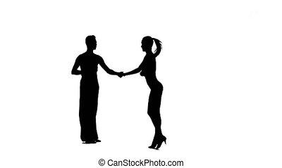 Silhouette pair professional dancers perform ballroom dance,...
