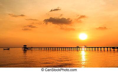 silhouette people on wood bridge with sunset