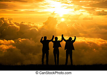 silhouette people winning concept business team man and woman with arms up in the air for success goal concept