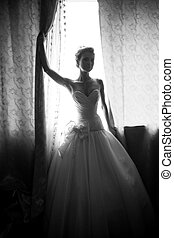 Silhouette photo of bride holding shade at window - Black...