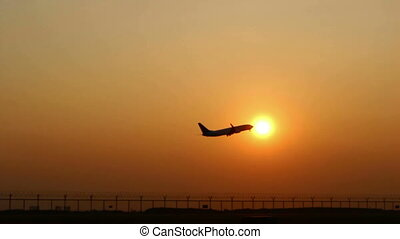 silhouette Plane Takes Off At Sunrise Background