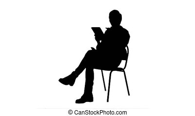 Silhouette Portrait of female doctor with tablet computer reading medical report.