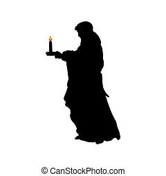 Silhouette praying man with candle