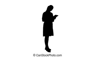 Silhouette Pretty female doctor with stethoscope glad to get a good results using digital tablet.