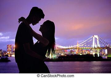 silhouette romantic lovers with Odaiba