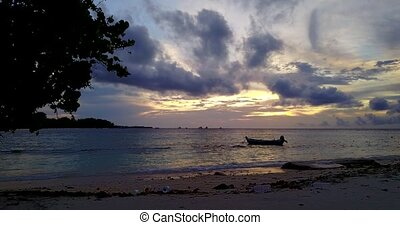 silhouette sailing boat at sunset sunrise with beautiful sky and sea on island beach