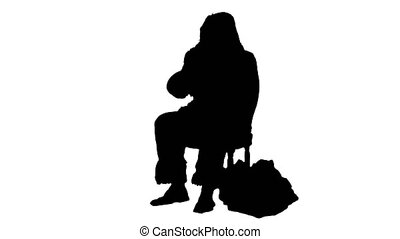 Silhouette Santa claus calling by mobile cell phone....