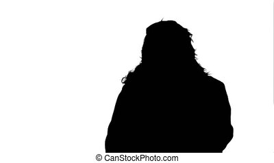 Silhouette Santa Claus calling with a mobile phone